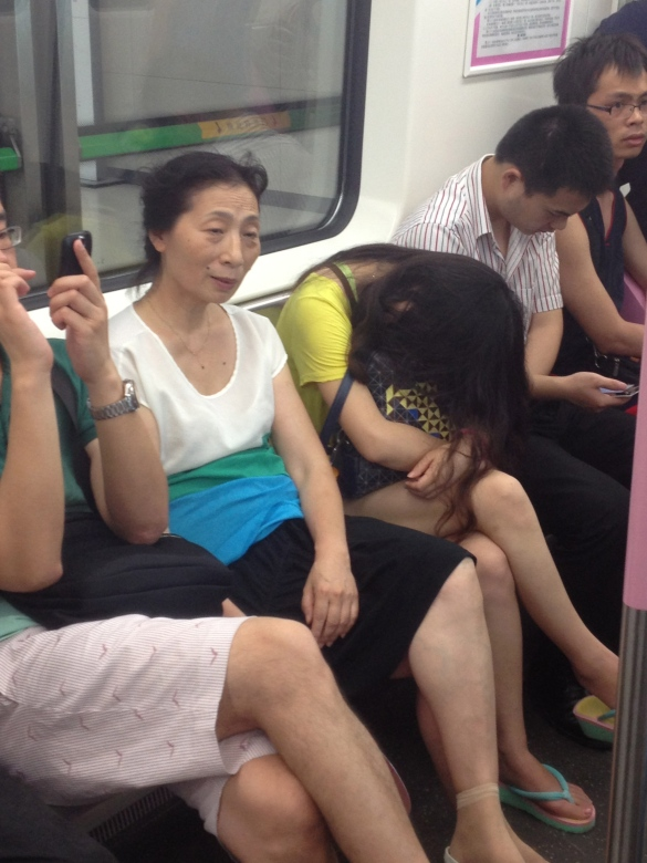 Chinese can sleep anywhere and in whatever position. Chinese girl sleeping in metro