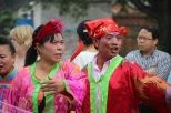 Grooms parents who are dressed like Chinese clowns