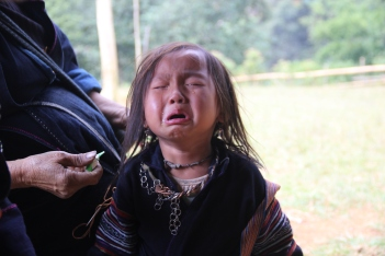 Small crying girl in Sapa